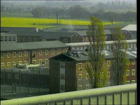 background englandcheshire risley remand centre prisoners on roof lms prisoners along on roof r - hm prison manchester stock videos & royalty-free footage