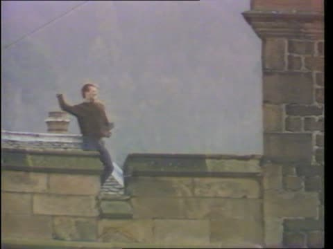 background scotland perth prison lms prisoner on roof with iron bar lms prisoner throwing roof slate lms prison officers with wire and builders - hm prison manchester stock videos & royalty-free footage