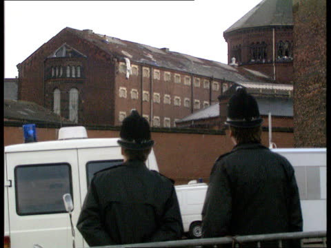day 18 england manchester strangeways prison prisoner on roof throwing things off roof prisoner smiling blowing kisses from roof prisoner on roof... - prison riot stock videos & royalty-free footage