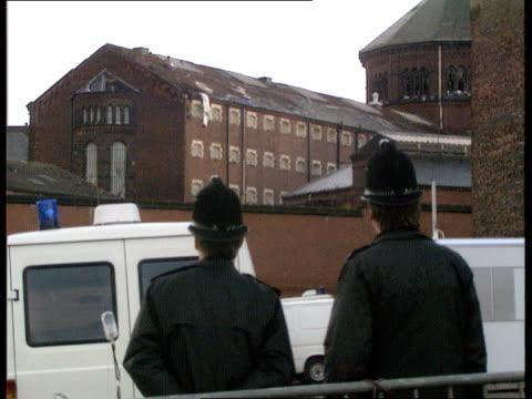 strangeways prison siege: day 18; england: manchester: strangeways prison: prisoner on roof throwing things off roof; prisoner smiling & blowing... - bodyweight training stock videos & royalty-free footage