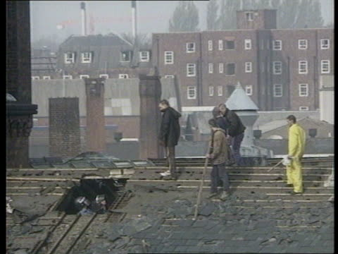the tactics itn today as riot officers on roof prisoners on roof talking to riot officers prisoners comming down - hm prison manchester stock videos & royalty-free footage