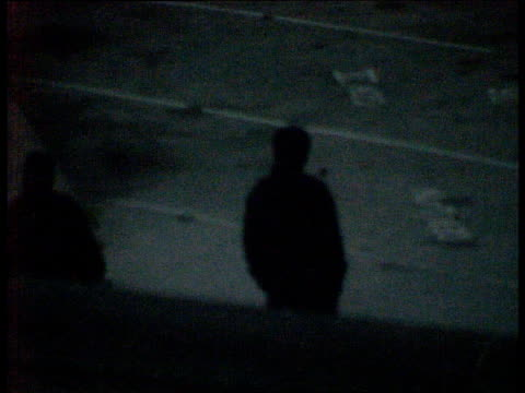 the tactics; night surveilance teams wearing masks along outside: - hm prison manchester stock videos & royalty-free footage