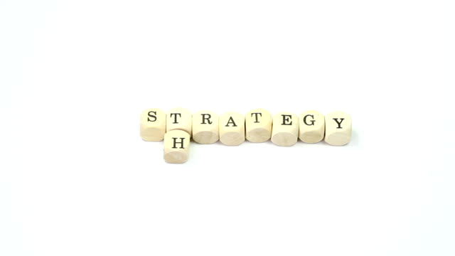 strategy crossword - two different time settings - wood material stock videos & royalty-free footage