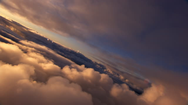 stratocumulus and sunglares - stratocumulus stock videos and b-roll footage
