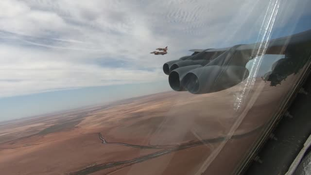 Stratofortress deployed from Barksdale Air Force Base Louisiana conducts a training mission with two Royal Moroccan Air Force F16 Fighting Falcons...