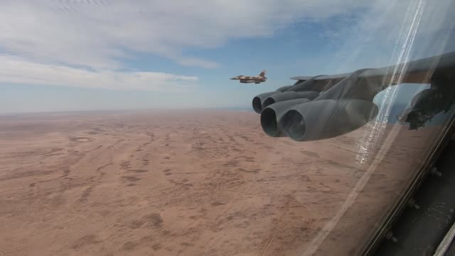 stratofortress deployed from barksdale air force base, louisiana, conducts a training mission with two royal moroccan air force f-16 fighting falcons... - bomber stock videos & royalty-free footage