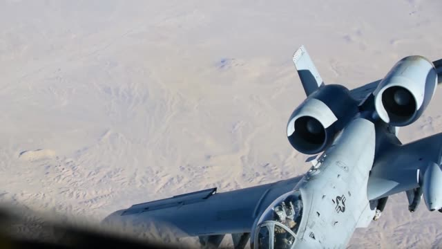 stratotanker assigned to the 340th air refueling squadron with the 451st air expeditionary group refuels an a10 thunderbolt ii assigned to the 75th... - カンダハール市点の映像素材/bロール