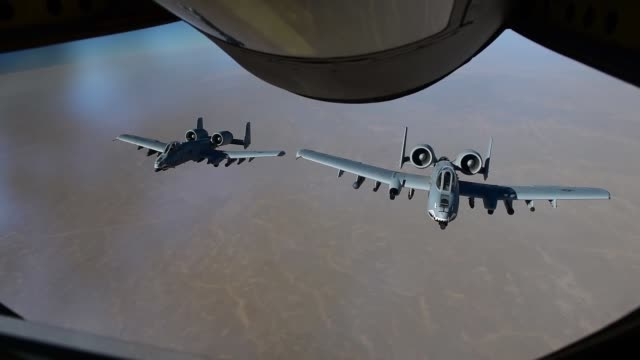 stockvideo's en b-roll-footage met stratotanker assigned to the 340th air refueling squadron with the 451st air expeditionary group refuels an a10 thunderbolt ii assigned to the 75th... - kandahar afghanistan