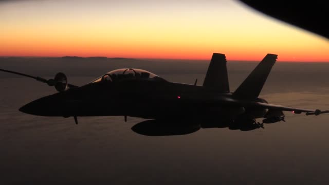 stratotanker assigned to the 340th expeditionary air refueling squadron al udeid air base qatar refuels a flight of us navy f/a18e/f super hornets... - night vision stock videos and b-roll footage
