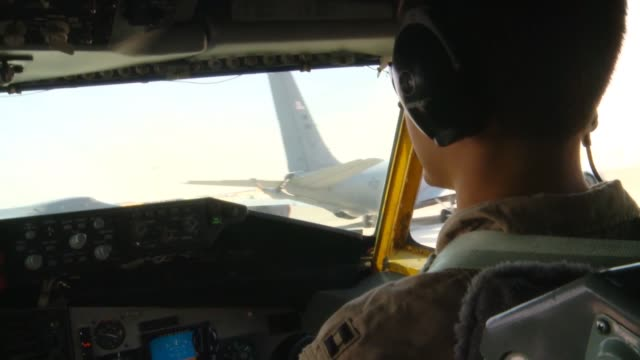 stratotanker crew members from the 340th expeditionary air refueling squadron refuel a b1b lancer over southern afghanistan in support of operation... - operation enduring freedom stock videos & royalty-free footage
