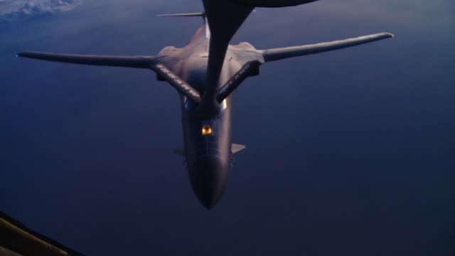stockvideo's en b-roll-footage met stratotanker crew members from the 340th expeditionary air refueling squadron refuel a b-1b lancer over southern afghanistan in support of operation... - operation enduring freedom