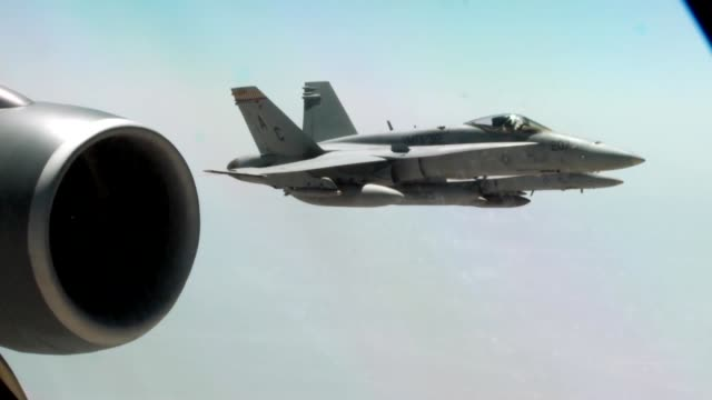 stockvideo's en b-roll-footage met stratotanker from the 340th expeditionary air refueling squadron air refuel f/a18c hornets over the skies of afghanistan in support of operation... - operation enduring freedom