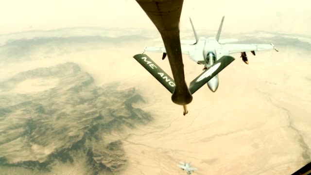 stratotanker from the 340th expeditionary air refueling squadron air refuel f/a18c hornets over the skies of afghanistan in support of operation... - operation enduring freedom stock videos & royalty-free footage