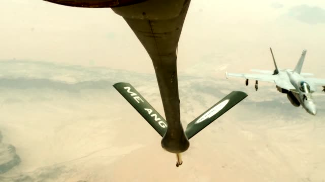 stratotanker from the 340th expeditionary air refueling squadron air refuel f/a-18c hornets over the skies of afghanistan in support of operation... - operation enduring freedom stock videos & royalty-free footage