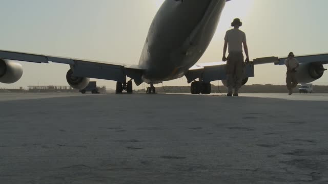 stratotanker maintainers and taxi shot from northern afghanistan - taxiway stock-videos und b-roll-filmmaterial
