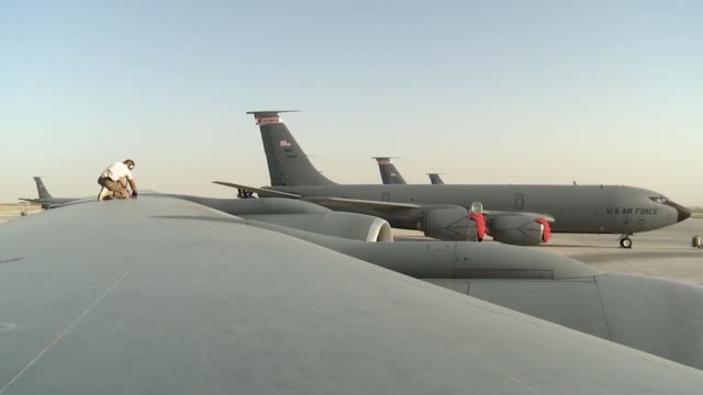 stratotanker maintainers and taxi shot from northern afghanistan - taxiway stock videos & royalty-free footage