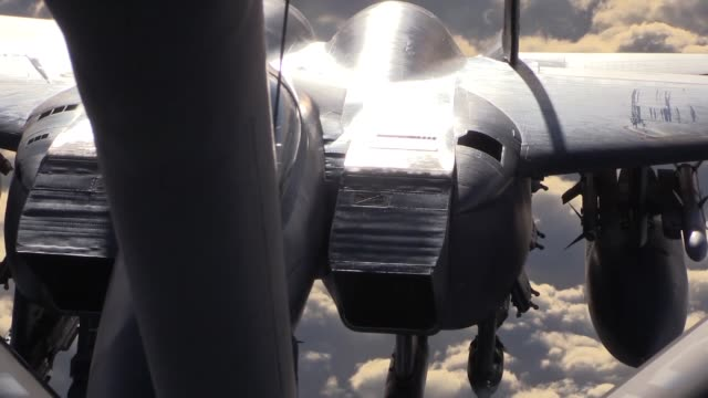stratotanker provides aerial refueling for f15e strike eagle above syria - mcdonnell douglas f 15 eagle stock videos & royalty-free footage
