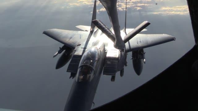 Stratotanker provides aerial refueling for F15E Strike Eagle above Syria