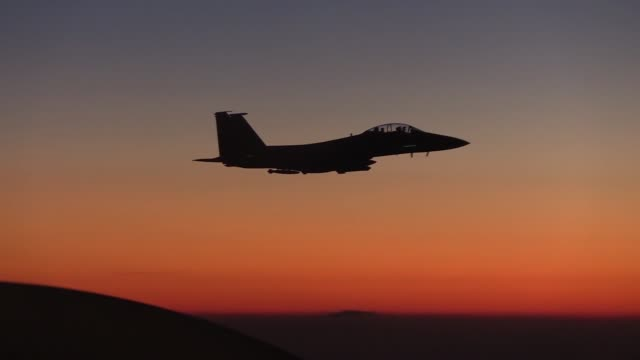 stratotanker provides aerial refueling for f15e strike eagle above syria - us airforce stock videos & royalty-free footage