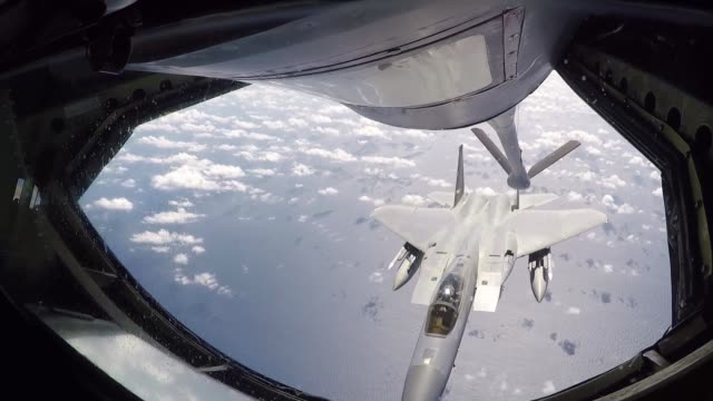 stratotanker refuels f15 eagles and f16 fighting falcons above the pacific ocean during the us pacific's largest multilateral exercise cope north 19 - north pacific stock videos & royalty-free footage