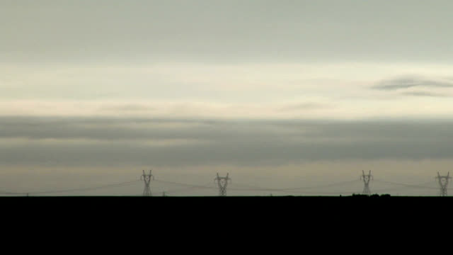 stratus clouds and pylons, timelapse - stratus stock videos & royalty-free footage