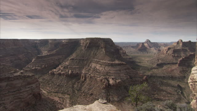 stratus clouds hang above scrublands and canyons in utah. available in hd - stratus stock videos & royalty-free footage
