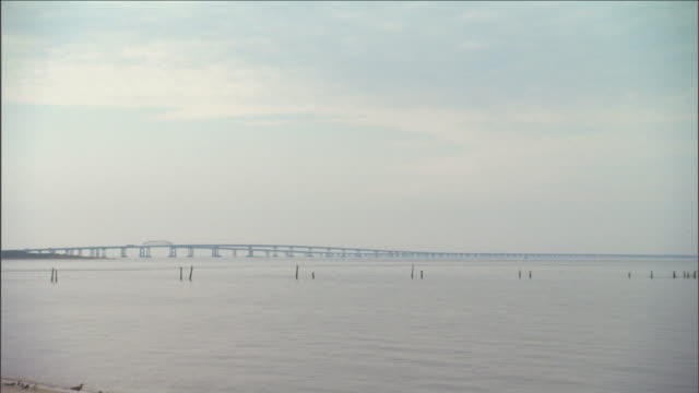 stratus clouds hang over a bridge in maryland. - stratus stock videos & royalty-free footage