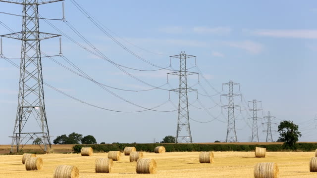 straw bales - electricity pylon stock videos and b-roll footage