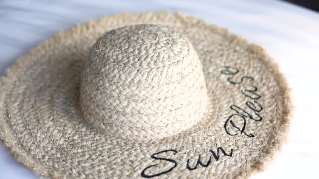 a straw beach sun hat. - sun hat stock videos & royalty-free footage
