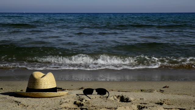 straw hat and sunglasses on the sand. - straw hat stock videos & royalty-free footage