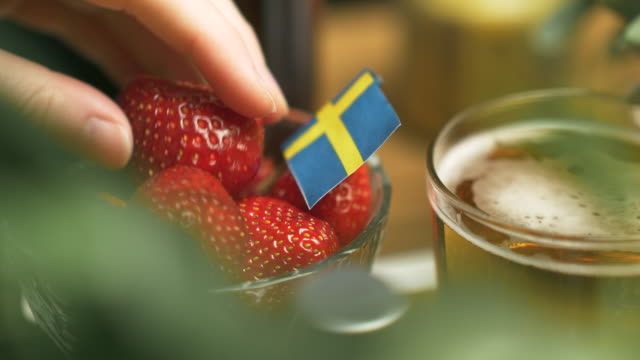 strawberries at a swedish midsummer dinner party - solstice stock videos & royalty-free footage