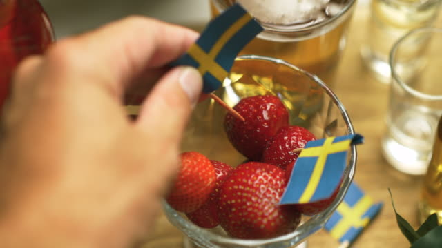strawberries at a swedish midsummer dinner party - buffet stock videos & royalty-free footage