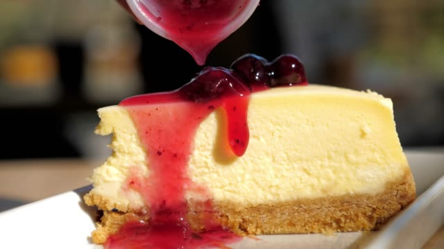 strawberries cheesecake with strawberry jam , slow motion - strawberry jam stock videos & royalty-free footage
