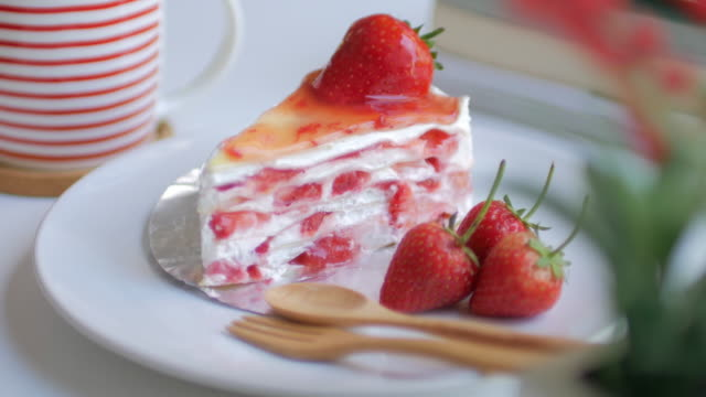 strawberries crepe cake with strawberry cream with dolly shot movement - cake stock videos and b-roll footage