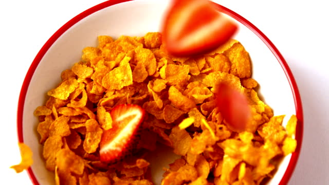 strawberries falling into bowl of cereal - bowl stock videos & royalty-free footage
