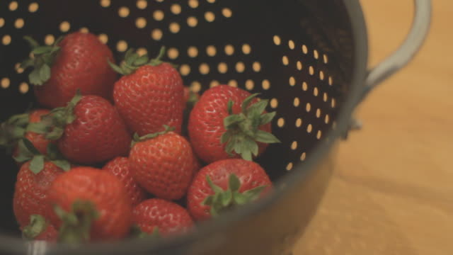 Strawberries in a strainer - static shot