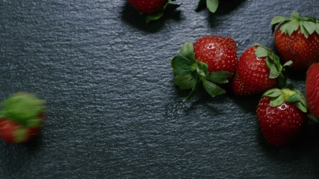 strawberries on slate in slow motion - slate rock stock videos and b-roll footage