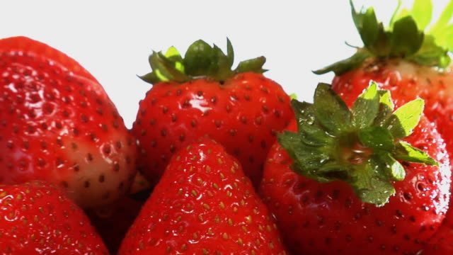 cu, strawberries rotating - medium group of objects stock videos & royalty-free footage