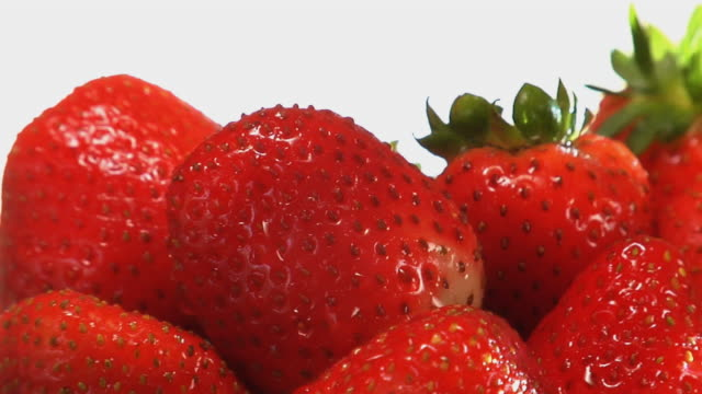 CU, TU, Strawberries rotating