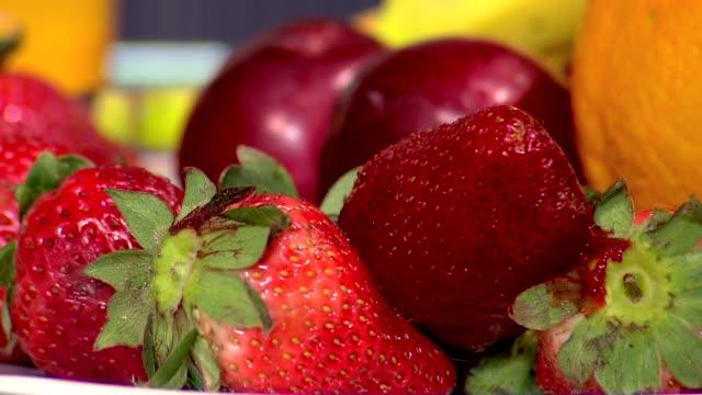 strawberries - plum stock videos & royalty-free footage