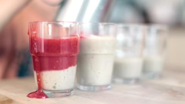 strawberry banana cocktail in glasses - strawberry milkshake stock videos & royalty-free footage