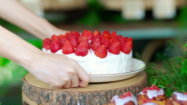 strawberry cheese cake serving by women. - cake stock videos & royalty-free footage