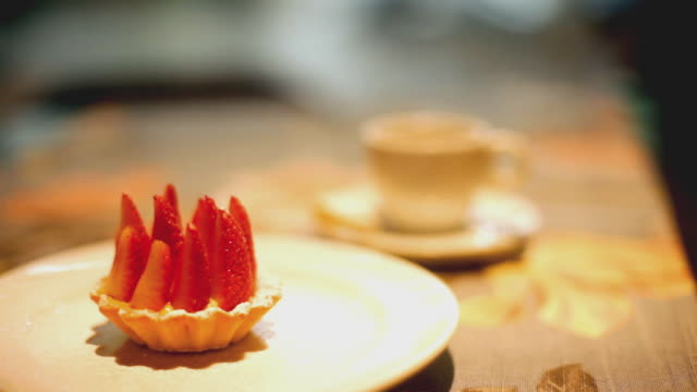 strawberry fruit tart and a cup of coffee - porto alegre stock-videos und b-roll-filmmaterial