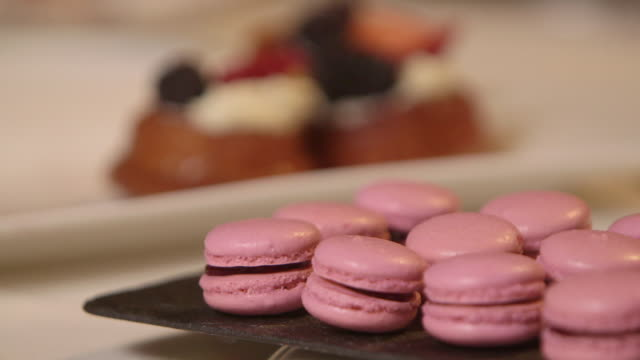 Strawberry macarons served by pastry chef