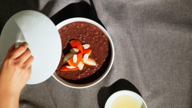vídeos de stock, filmes e b-roll de strawberry 'patjuk' (korean red bean porridge) - bean
