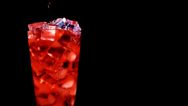 strawberry soda pouring into glass of ice at slow motion on a black background - cherry stock videos & royalty-free footage