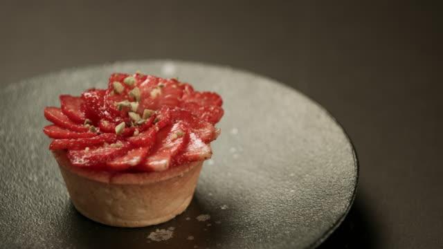 strawberry tarts with custard - black background - custard stock videos & royalty-free footage