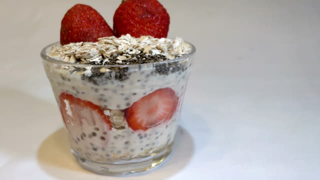 strawberry with cereals and yogurt without ice cold cup to eat of delight - trifle dessert stock videos and b-roll footage