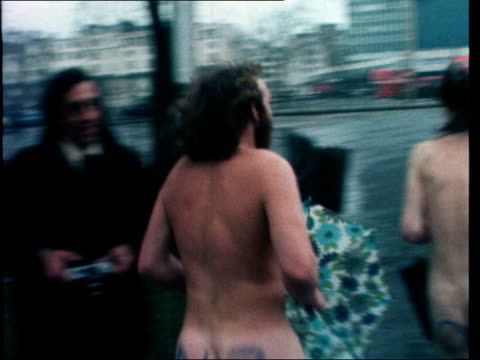 london hyde park bv three streakers run one over railing falls gets up pan as he runs rl sof 'hi there folks' ms two towards and past to bv cms one... - offbeat stock videos and b-roll footage
