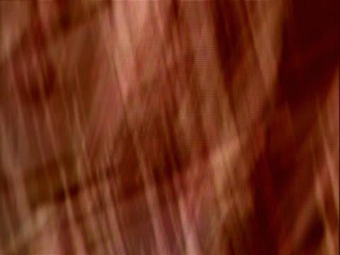 streaks criss-crossing in warm tones - crisscross stock videos & royalty-free footage